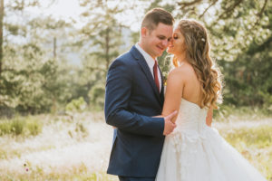 Photo of a couple standing close to each other, an example of Kaela's work as a wedding photographer in denver
