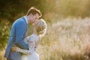 Photo of a couple kissing at sunset, an example of Brittany's wedding photography denver co work