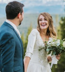 Photograph of a happy couple smiling at each other at a Colorado wedding