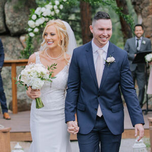 Happy couple leaving their Colorado wedding ceremony