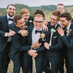 Groomsman laughing at Denver Wedding