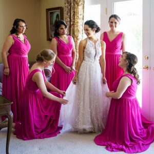 bride surrounded by bridesmaids before wedding by Wanderlight, A Phoenix wedding photography company