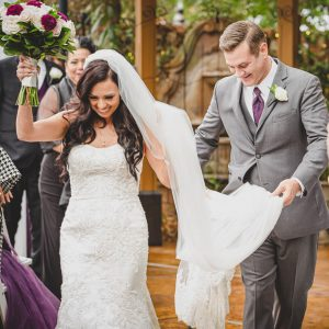 bride and groom laughing as they exit ceremony by Wanderlight, A Phoenix wedding photography company