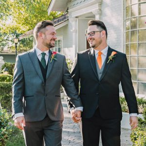 same sex grooms holding hands by Wanderlight, A Phoenix wedding photography company