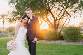 Phoenix wedding photograph of bride and groom hugging at sunset