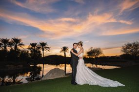 Phoenix wedding photograph of bride and groom at sunset with palm trees