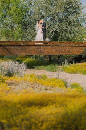 Phoenix wedding photograph of couple kissing on a bridge