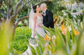 Phoenix wedding photograph of bride and groom kissing in garden