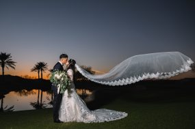 Phoenix wedding photograph of bride and groom kissing at sunset