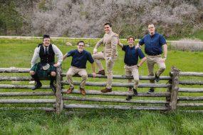 Phoenix wedding photograph of groomsman on fence