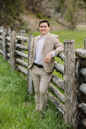 Phoenix wedding photograph of groom leaning on fence