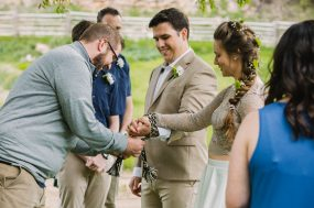 Phoenix wedding photograph of tying the knot at ceremony