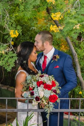 Phoenix wedding photograph of groom kissing his bride on forehead