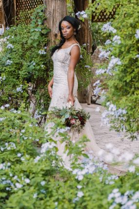 Phoenix wedding photograph of black bride surrounded by flowers