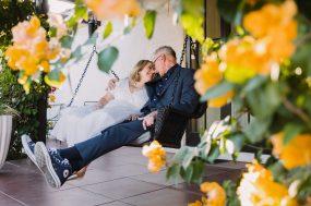 Phoenix wedding photograph of older couple on porch swing