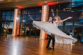 Phoenix wedding photograph of groom swinging bride at first dance