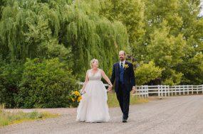Phoenix wedding photograph of bride and groom walking down dirt road