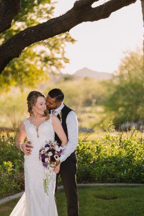 Phoenix wedding photograph of groom kissing bride