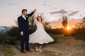 Phoenix wedding photograph of groom spinning bride at sunset