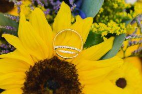 Phoenix wedding photograph of wedding rings on sunflower