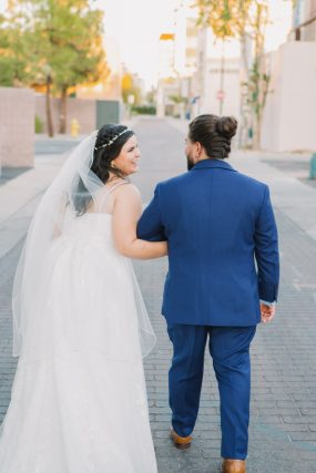 Phoenix wedding photograph of couple walking down street