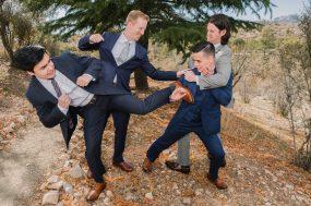 Phoenix wedding photograph of groomsmen pretend fighting