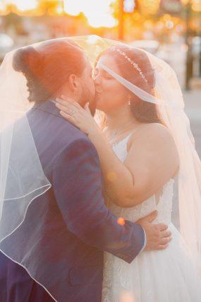 Phoenix wedding photograph of couple kissing at sunset