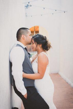 Phoenix wedding photograph of groom kissing bride's forehead