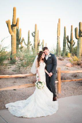 Phoenix wedding photograph of bride and groom with cactus