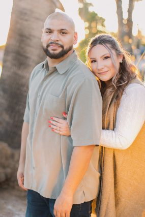 Phoenix engagement photograph of couple near palm trees