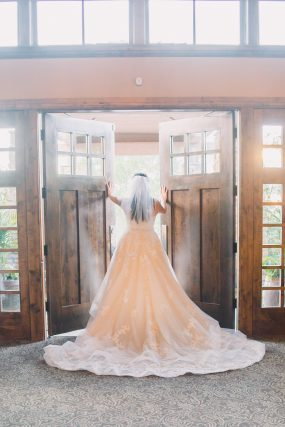 Phoenix wedding photography of bride's dress in doorway