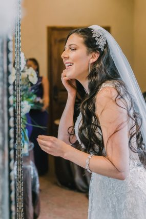 Phoenix wedding photography of bride putting on earrings
