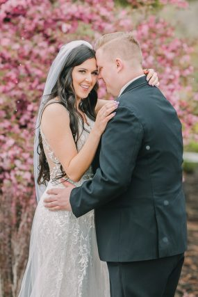 Phoenix wedding photography of bride and groom with cherry blossoms