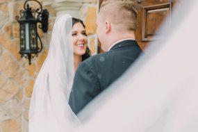 Phoenix wedding photography of bride smiling at groom