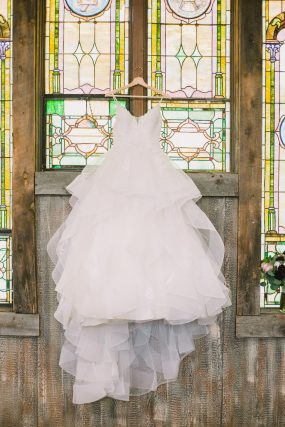 Phoenix wedding photography of bridal gown in church