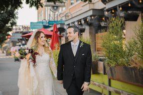 Phoenix wedding photograph of bride and groom walking down street