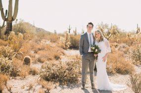 Phoenix wedding photograph of couple in desert with cactus