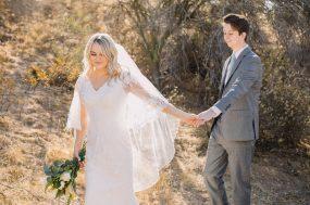 Phoenix wedding photograph of bride and groom holding hands