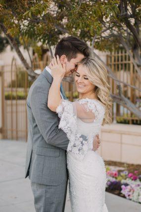 Phoenix wedding photograph of couple hugging downtown