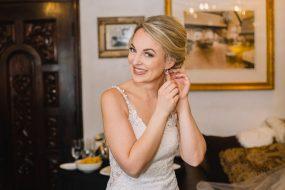 Phoenix wedding photography of bride putting in earrings