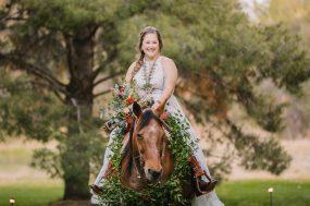 Phoenix wedding photograph of bride riding on horse