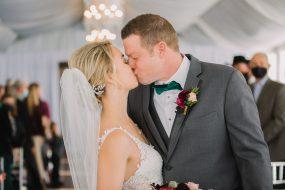 Phoenix wedding photography of couple kissing after wedding ceremony