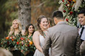 Phoenix wedding photograph of bride smiling during wedding ceremony