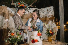 Phoenix wedding photograph of couple cutting wedding cake