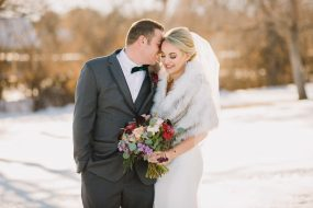 Phoenix wedding photography of bride and groom in snow