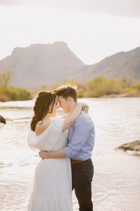 Phoenix engagement photograph of couple hugging on river