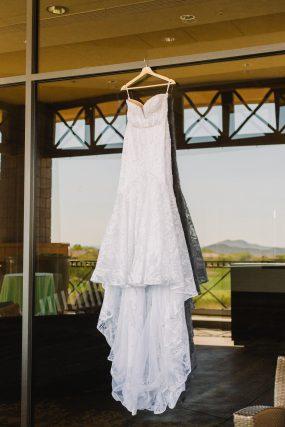 Phoenix wedding photography of bride's dress hanging up