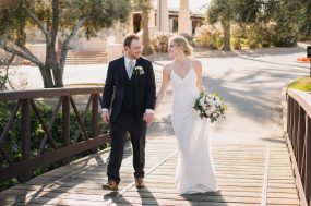 Phoenix wedding photograph of couple walking on bridge