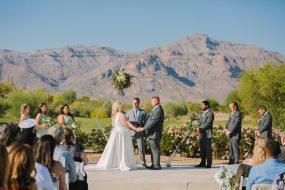 Phoenix wedding photography of wedding ceremony with mountains
