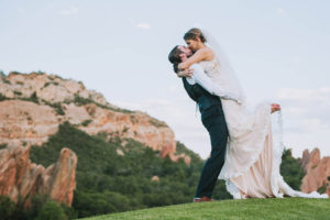 Photo of a couple kissing, an example of Nate's work as wedding photographers Denver